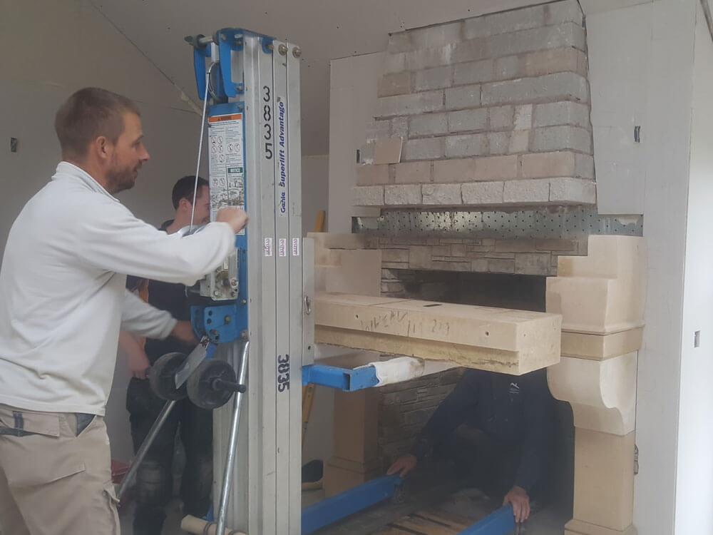 Stone fireplace installation with 3 men, installing mantel shelf, Sandridge Stone Fireplaces, Limestone, Bath Stone, Portland Limestone, Melksham, Wiltshire