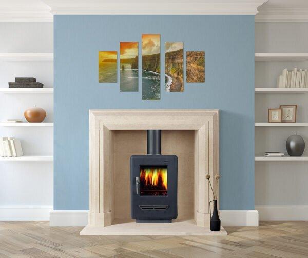 Limestone carved fireplace with log burner fire, blue wall, Sandridge Stone Fireplaces, Limestone, Bath Stone, Portland Limestone, Melksham, Wiltshire
