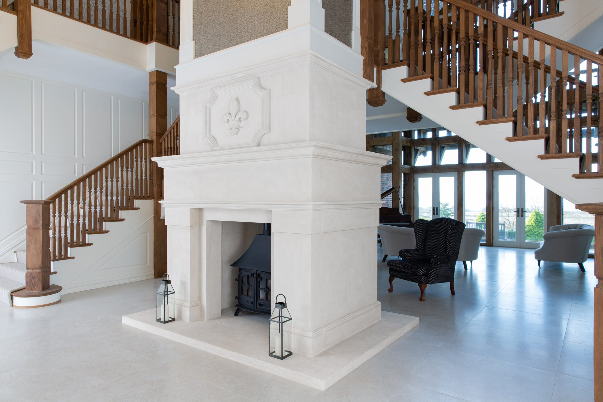 Grand feature fireplace between two staircases, Sandridge Stone Fireplaces, Limestone, Bath Stone, Portland Limestone, Melksham, Wiltshire